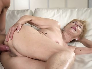 A horrific grey granny gets a steadfast dick between her limbs on the sofa